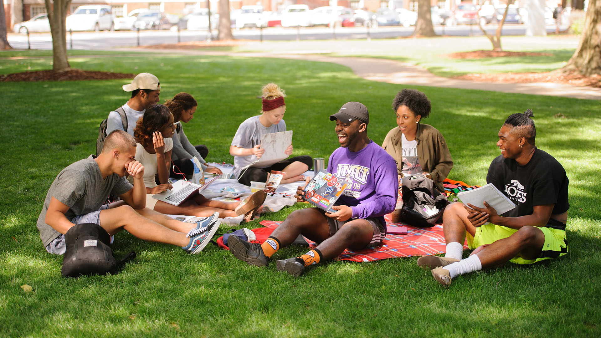 A group of students study on the quad