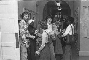 A group of studentsin 70s clothing in the school's halls