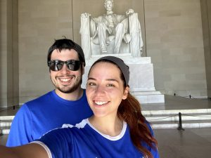 a white woman and white man pose for a picture in front of the Lincoln Monument